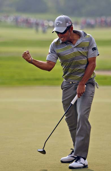 Pablo Larrazabal  raises his fist in celebration after winning the final round of the Abu Dhabi HSBC Golf Championship in Abu Dhabi, United Arab Emirates, Sunday Jan. 19, 2014.