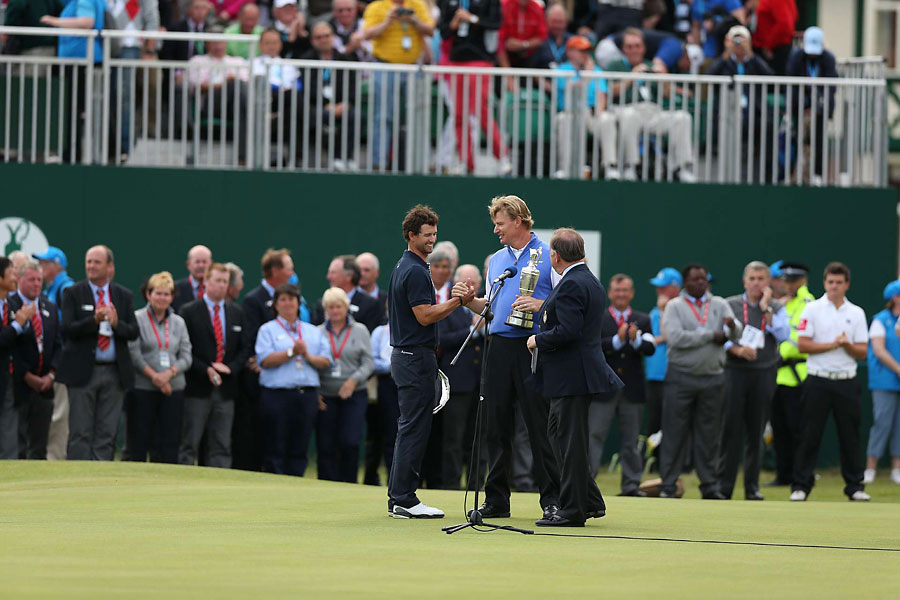 "Great Big Men                           Both Adam Scott and Ernie Els are pretty big guys who carry their weight well, but did you notice how small Scott looked next to Els at the end? Scott is 6' 180 lbs. Els is 6'3"" 220. Two handsome lads, but the contrast was surprising."