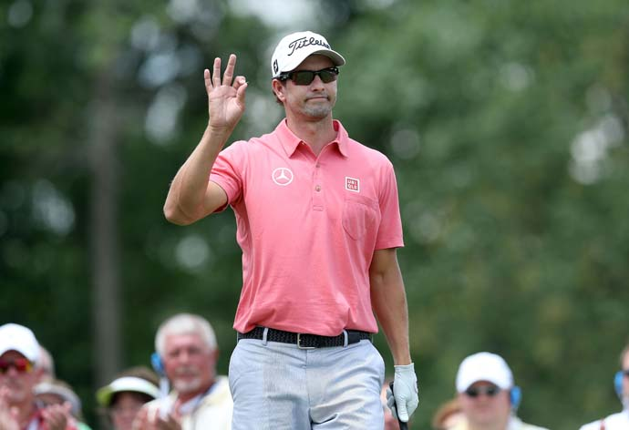 Adam Scott waves to fans on the first tee. Scott shot 73 on Sunday to finish T13.