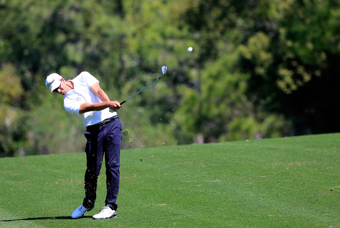 Adam Scott jumped into contention Friday with a bogey-free 66.