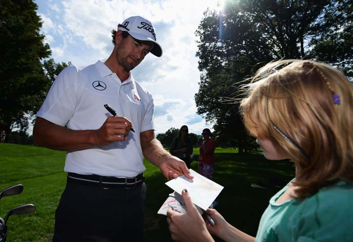 Adam Scott signs an autograph for a fan Monday at Oak Hill.