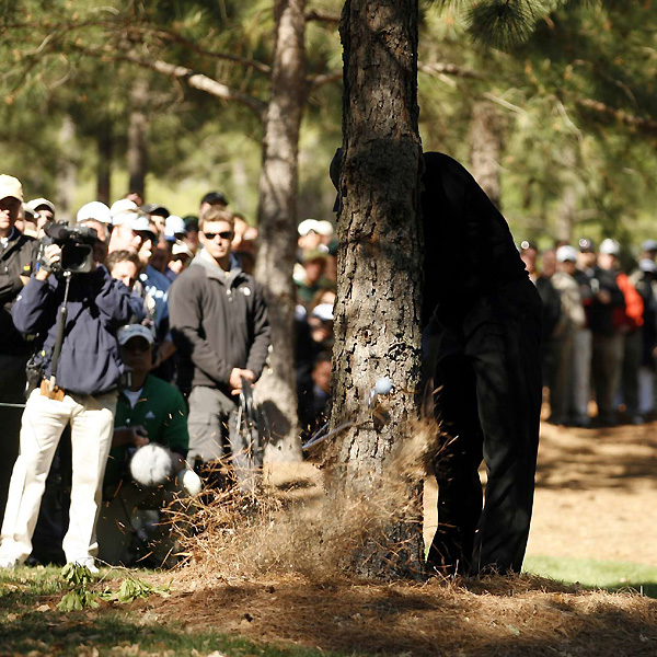 Woods snapped an iron while punching out from behind a tree on the 11th hole.                       After the shot, he picked it up and finished the job, snapping it in two. He saved par on the hole to stay five over.