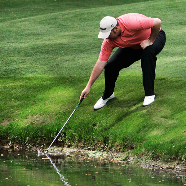 Kenneth Ferrie, who is making his first start at the Masters, retrieved his ball from the water on No. 12.