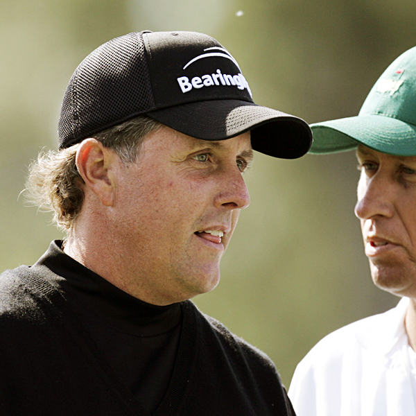 Mickelson and caddie Jim Mackay had a lot to talk about after Mickelson's opening-nine 40.