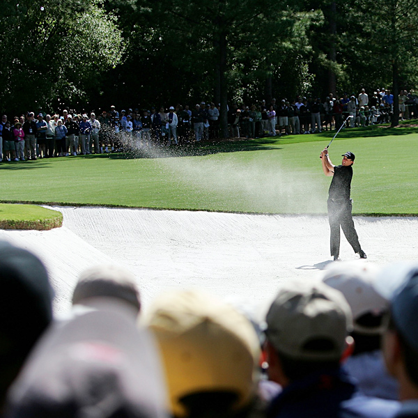 Phil Mickelson tried to recover from a fairway bunker at No. 1, but he made a bogey to start his opening round.