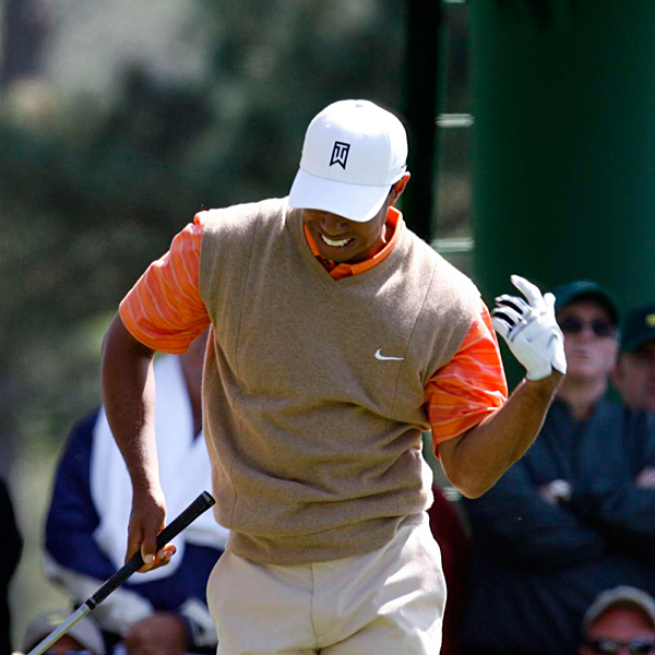 Woods said he strained himself while trying to stop his swing when a bird flew over his head on No. 13.