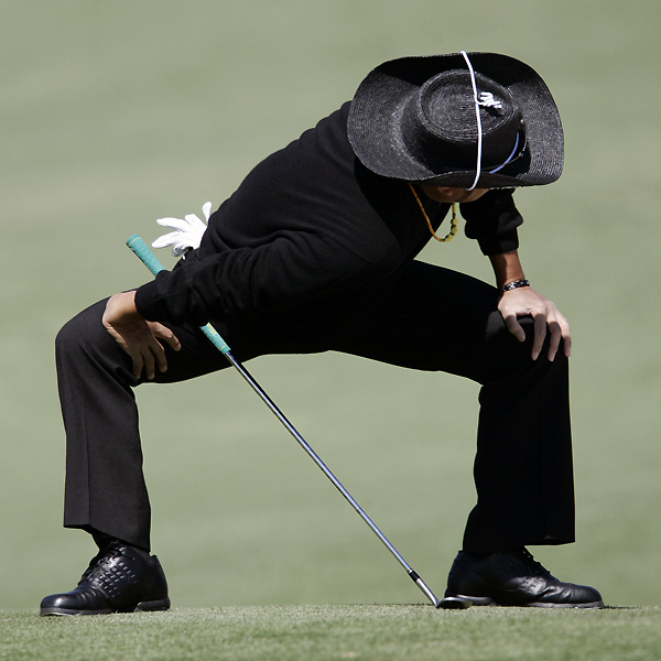 Shingo Katayama tried to stay loose in the cold on the 2nd hole.