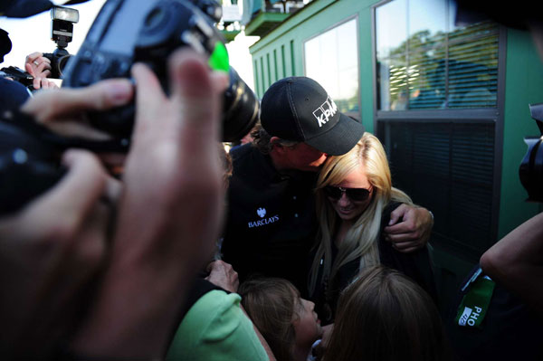 Mickelson's wife, Amy, who is battling breast cancer, was there to greet her husband.