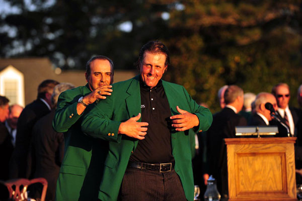 receiving the green jacket from Angel Cabrera, the 2009 champ. Mickelson tied Jimmy Demaret, Nick Faldo, Sam Snead and Gary Player with his third Masters win. Only Tiger Woods and Arnold Palmer (four apiece) and Jack Nicklaus (six) have more.