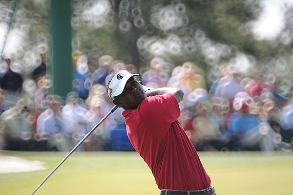 Vijay Singh followed up his bogey on the first hole with a birdie on the second hole. He is seven strokes off the lead at one under par.