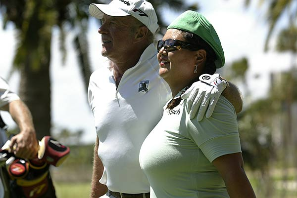 After playing 18 holes with Christina Kim Thursday, actor James Caan said her positive outlook and smile helped a lot.