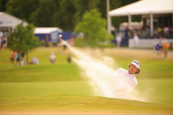 Bubba Watson got up-and-down from a greenside bunker on 18 for birdie and a share of the lead with Webb Simpson heading into the final round.