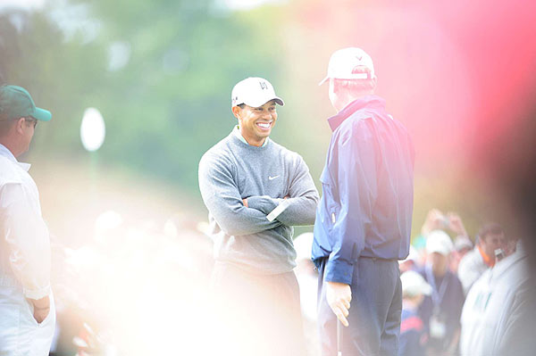 Tiger Woods, talking with Ernie Els here, stopped by the practice green on Monday afternoon.