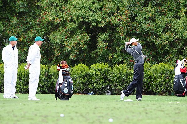 The world's No. 1 golfer hit a few balls with caddie Steve Williams looking on.