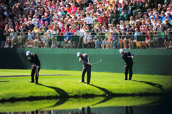 In one of the many traditions at the Masters, players try to skip balls across the water at the par-3 16th.