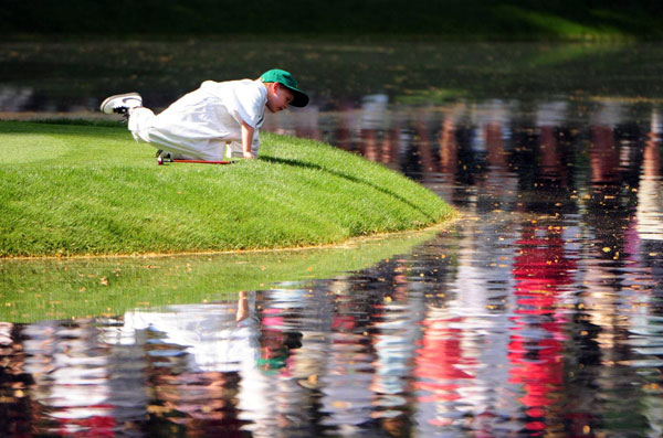 One caddie took a break from the action to play near the water.
