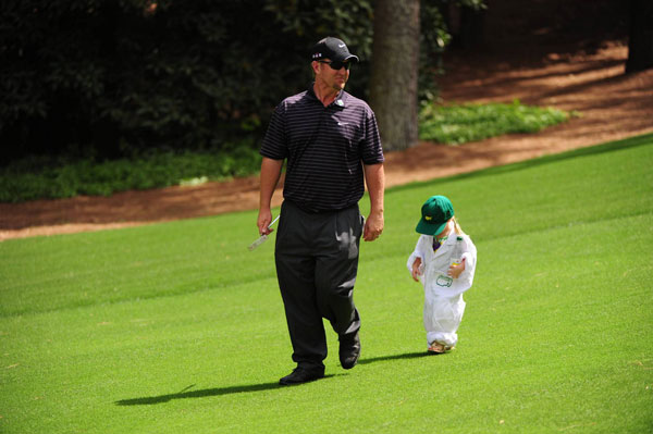 was one of several players to bring their little ones on the course.