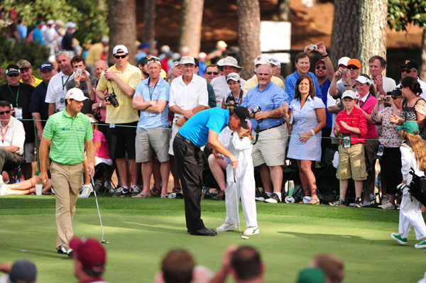 Mickelson listened closely as his daughter gave him a putting tip.