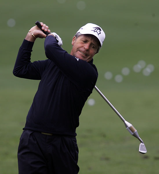 Gary Player warmed up on the practice range with a weighted club.                                                      • GOLF Magazine Interview: Gary Player