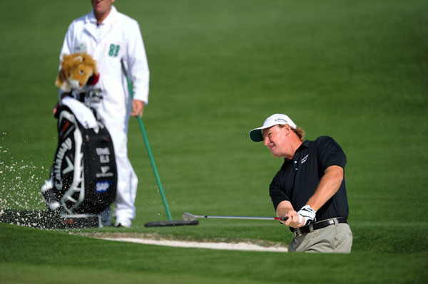 Ernie Els was 3-under par until making a double bogey on 18.
