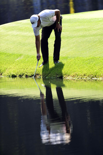 "Phil Mickelson tried to fish his ball out after hitting it in the water.                                                                                 function fbs_click() {u=""http://www.golf.com/golf/gallery/article/0,28242,1890259,00.html"";t=document.title;window.open('http://www.facebook.com/sharer.php?u='+encodeURIComponent(u)+'&t='+encodeURIComponent(t),'sharer','toolbar=0,status=0,width=626,height=436');return false;} html .fb_share_link { padding:2px 0 0 20px; height:16px; background:url(http://b.static.ak.fbcdn.net/images/share/facebook_share_icon.gif?8:26981) no-repeat top left; }Share on Facebook                                                                                                            addthis_pub             = 'golf';                            addthis_logo            = 'http://s9.addthis.com/custom/golf/golf_logo.jpg';                           var addthis_offset_top = -155;                           addthis_logo_color      = '555555';                           addthis_brand           = 'Golf.com';                           addthis_options         = 'email, facebook, twitter, digg, delicious, myspace, google, reddit, live, more'                                                                                  Share"
