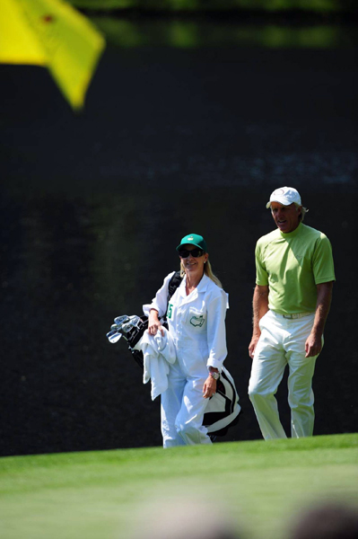 "Not everyone brought their kids. Greg Norman had his new bride, Chris Evert, caddie for him.                                                                                 function fbs_click() {u=""http://www.golf.com/golf/gallery/article/0,28242,1890259,00.html"";t=document.title;window.open('http://www.facebook.com/sharer.php?u='+encodeURIComponent(u)+'&t='+encodeURIComponent(t),'sharer','toolbar=0,status=0,width=626,height=436');return false;} html .fb_share_link { padding:2px 0 0 20px; height:16px; background:url(http://b.static.ak.fbcdn.net/images/share/facebook_share_icon.gif?8:26981) no-repeat top left; }Share on Facebook                                                                                                            addthis_pub             = 'golf';                            addthis_logo            = 'http://s9.addthis.com/custom/golf/golf_logo.jpg';                           var addthis_offset_top = -155;                           addthis_logo_color      = '555555';                           addthis_brand           = 'Golf.com';                           addthis_options         = 'email, facebook, twitter, digg, delicious, myspace, google, reddit, live, more'                                                                                  Share"