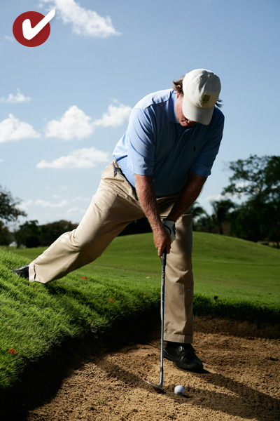 HOW TO BLAST OFF ONE FOOT                                                          STEP 1                                                          Step into the sand, set your left heel even with the ball and flare your left foot open (for extra balance). Then place your right foot on the hill behind the bunker. Place it far enough up the hill to make your shoulders and hips even with the slope.