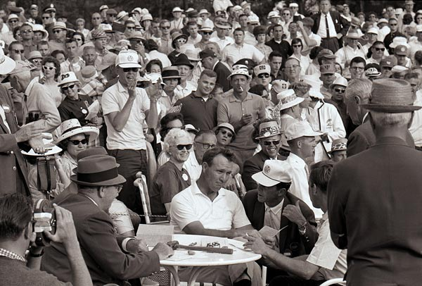 Palmer signed his winning card at the 1964 Masters, he became the first player to claim four green jackets.