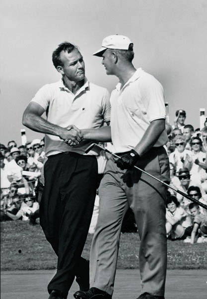 A gracious Arnold Palmer congratulates Jack Nicklaus for winning the 1962 U.S. Open at Oakmont Country Club.