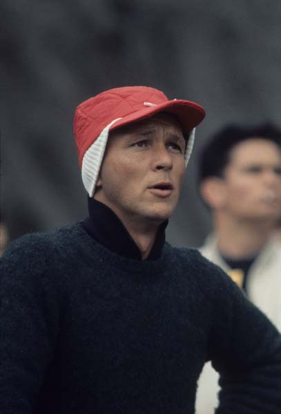 Arnold Palmer tries to stay warm at a tournament in Baton Rouge, La., in March 1962.