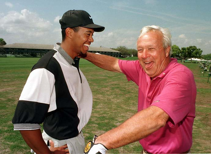 Arnold Palmer and Tiger Woods share a light moment at Palmer's Bay Hill Club in March 1997.