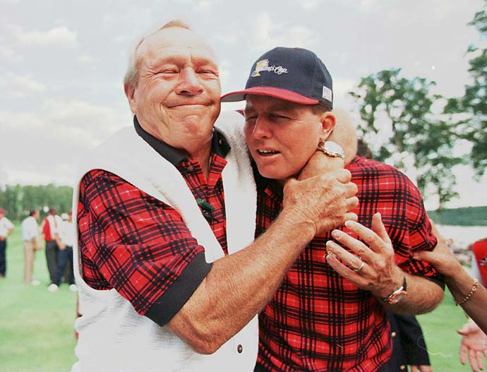 Arnold Palmer hugs U.S. team member Scott Hoch after their victory over the International Team at the 1996 Presidents Cup at the Robert Trent Jones Golf Club at Lake Manassas, Va.