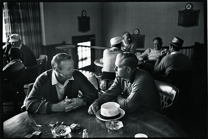 Arnold Palmer and Jack Nicklaus sitting at a table at Laurel Valley Country Club during the 1965 PGA Championship in Ligonier, Pa on July 1, 1965. The Championship was won by Dave Marr.