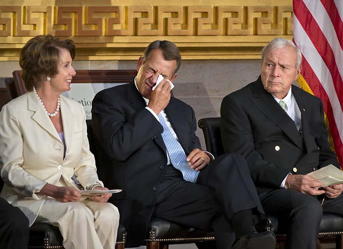 "Speaker of the House John Boehner of Ohio, himself an avid golfer, flanked by House Minority Leader Nancy Pelosi of Calif.,  and Arnold Palmer, wipes his eyes as singer Vince Gill sings ""You've Got a Friend,"" during a ceremony in the Capitol Rotunda in Washington, on Sept. 12, 2012, honoring Palmer with a Congressional Gold Medal."
