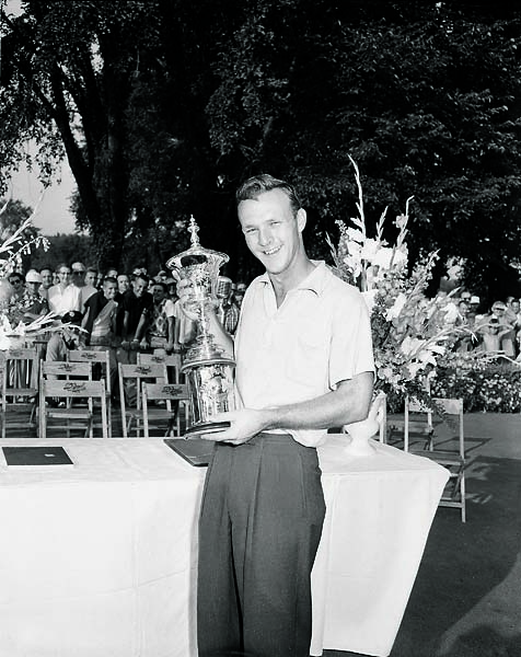 Arnold Palmer holds the 1954 U.S. Amateur trophy.