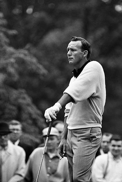 Arnold Palmer smokes a cigarette during Friday play at the Thunderbird Classic at Westchester Country Club in Rye, N.Y., in June 1963.