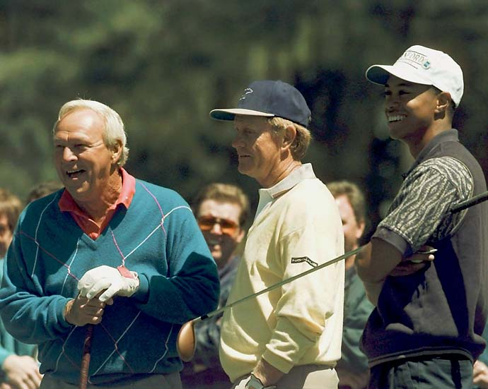 Arnold Palmer, Jack Nicklaus and Tiger Woods watch from the 15th tee during a practice round at the 1996 Masters.