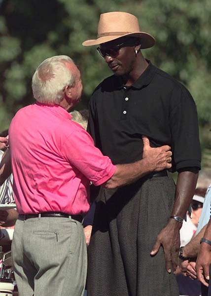 Arnold Palmer shares words with Michael Jordan prior to teeing off from the tenth tee during the Bob Hope Chrysler Classic at the Bermuda Dunes Country Club in Indio, Calif., in January 1999.