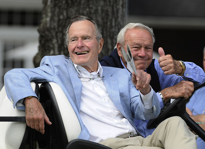 Former President George H. W. Bush and Arnold Palmer acknowledge the gallery at the Champions Tour golf tournament Friday, Oct. 22, 2010, in The Woodlands, Texas