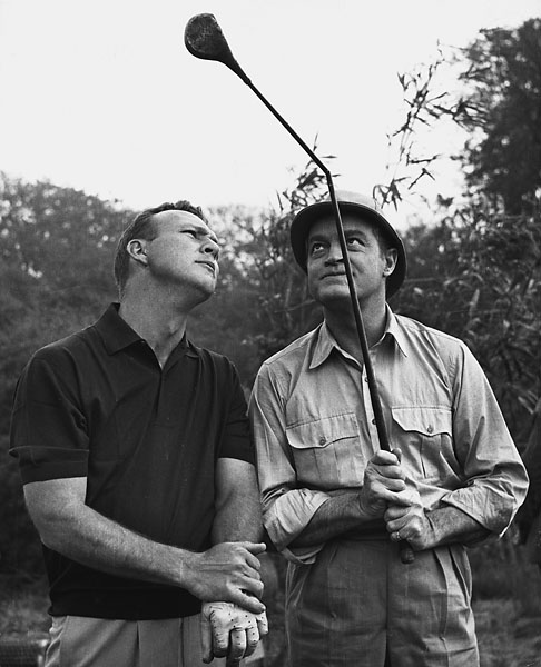 "Bob Hope shows a bent golf club to the golfer Arnold Palmer on location during the filming of the movie ""Call Ma Bwana"" on Oct. 16, 1962"