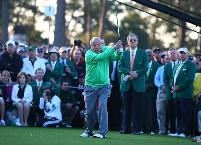 Arnold Palmer follows through and finds the fairway.