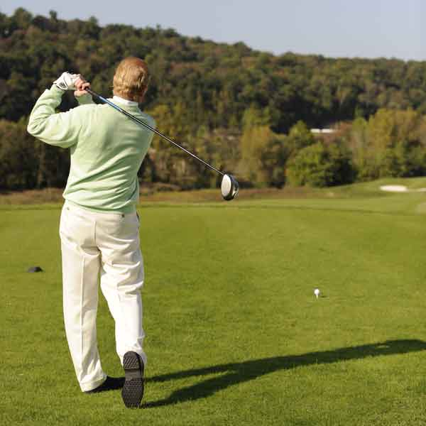 2. Take a deep breath to relax and make a practice swing in the direction of your target.
