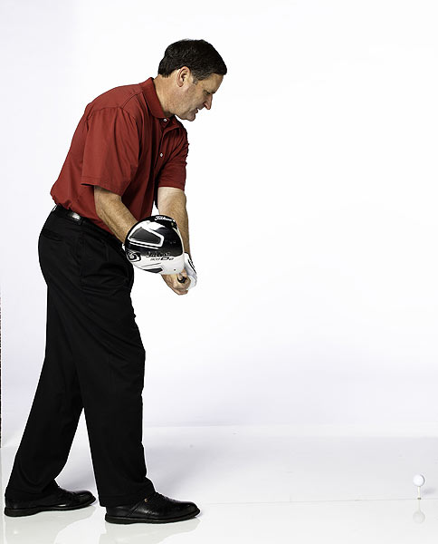 THE DRILL                            Take a very narrow stance, then drop your front foot back about a foot. Tee up the ball and try to hit shots without losing your balance. This drill forces you to swing your arms more in front of your body and keeps the path from being too shallow and too in-to-out.                            CLUBFITTING TIP                             You need to decrease spin to get in the fairway more often. Try using a shorter shaft, so you can make a more repeatable and controlled swing. (Your current shaft might be promoting a shallow swing path.) You'll likely strike the center of the face more often, which increases ball speed. You might consider a lower-spinning driver head, more loft and a softer shaft flex.