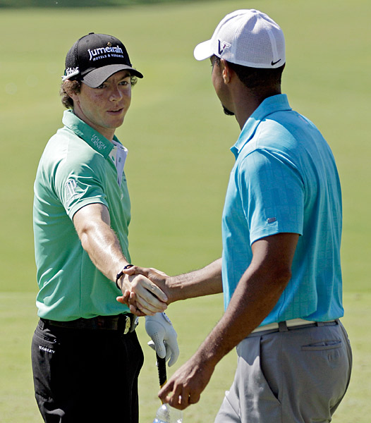 Rory McIlroy greeted Woods Wednesday on the course.