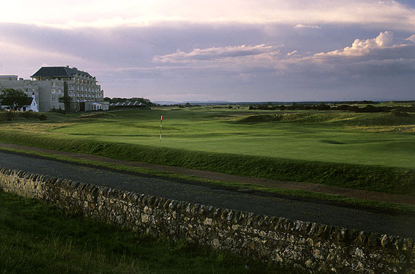"Hole No. 15                           St. Andrews (Old Course)                           St. Andrews, Scotland                           17th hole; par 4, 455 yards                                                      The most famous hole in the world, and arguably the best 'quirky' hole in the game. The tee shot calls for a 180-yard carry over dark green sheds, though your aiming point is right over the ""Old Course Hotel"" sign. To the right is out of bounds, but the risky play down the right earns a much better angle into the green. Timid souls who play down the left side bring the Road Bunker into play, a frighteningly deep, stacked sod monstrosity that guards the left front of the green. Overcook your approach and a pebble road-and a stone wall-will likely come into play. This unique hole has no parallel anywhere."