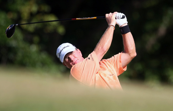 Scott Verplank, a graduate of Oklahoma State, shot 66 to finish four under par, two shots behind Tiger Woods.