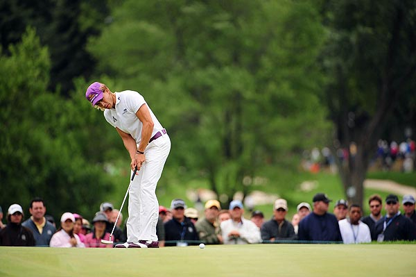 Camilo Villegas, sporting purple hat, belt and shoes, shot 68 to finish at one over par.