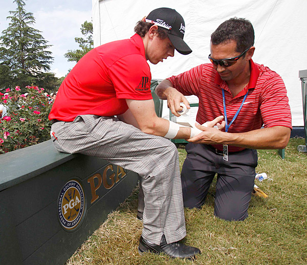 Later in the round, McIlroy had his wrist taped for stability and support.