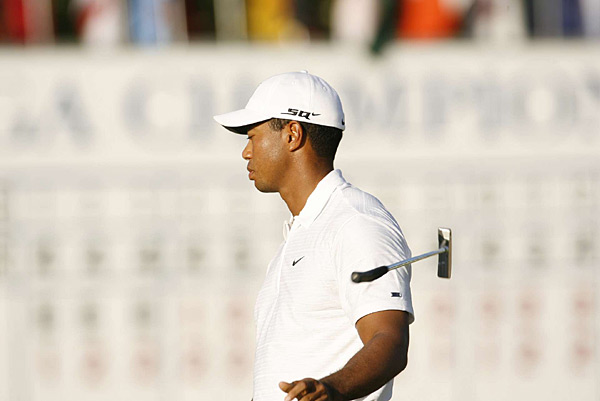 Woods after lipping out his putt on the final hole that would have given him a 62 and the record for the lowest round in a major tournament. Twenty-one others have carded a 63, and Greg Norman and Vijay Singh have done it twice.