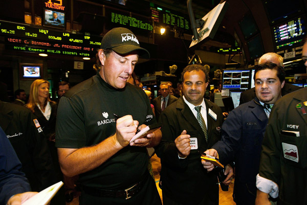 After ringing the opening bell, Mickelson signed autographs on the trading floor.
